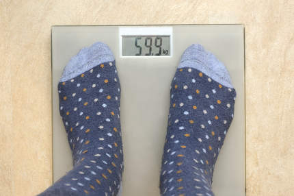 Feet In Socks On Weight Scale