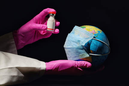 Female Hand Hold Earth With Mask And Vaccine