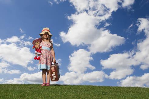 Girl holding vintage suitcase