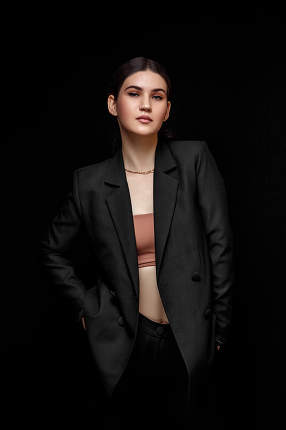 High fashion expressive portrait of young elegant woman in black
