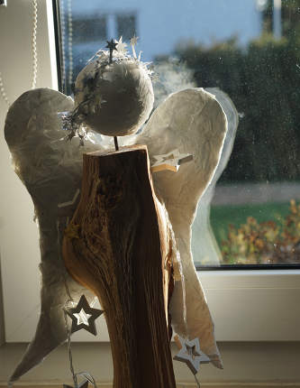 homemade wooden angel on the window, Christmas decoration