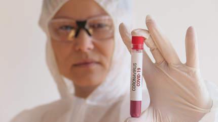 Nurse holding a blood test result