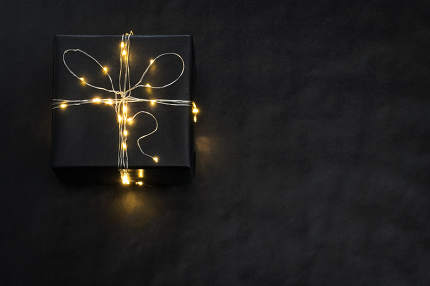 Present Box wrapped with string lights