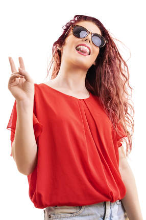 Redhead girl with tongue out and peace sign