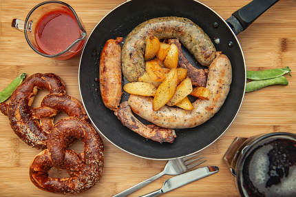 sausage grill in a cast iron pan on wooden table