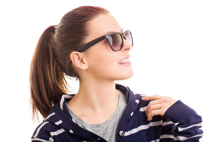 Smiling young girl wearing sunglasses