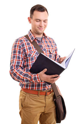 Smiling young male student looking at an open book