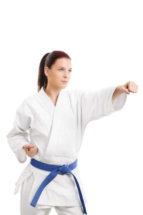 Young woman in a kimono punching