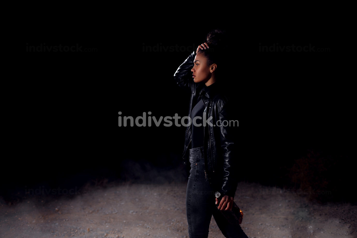 a young girl, African-American mulatto girl in a leather jacket and black clothes