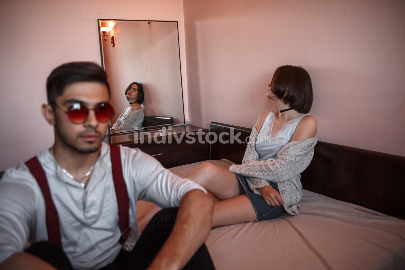 a young swarthy guy and a young brunette girl are sitting on the