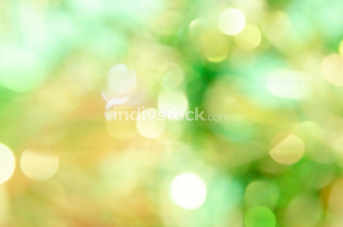 Abstract blurred yellow and green bokeh on background