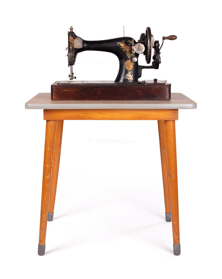 Antique, vintage sewing machine on an old table