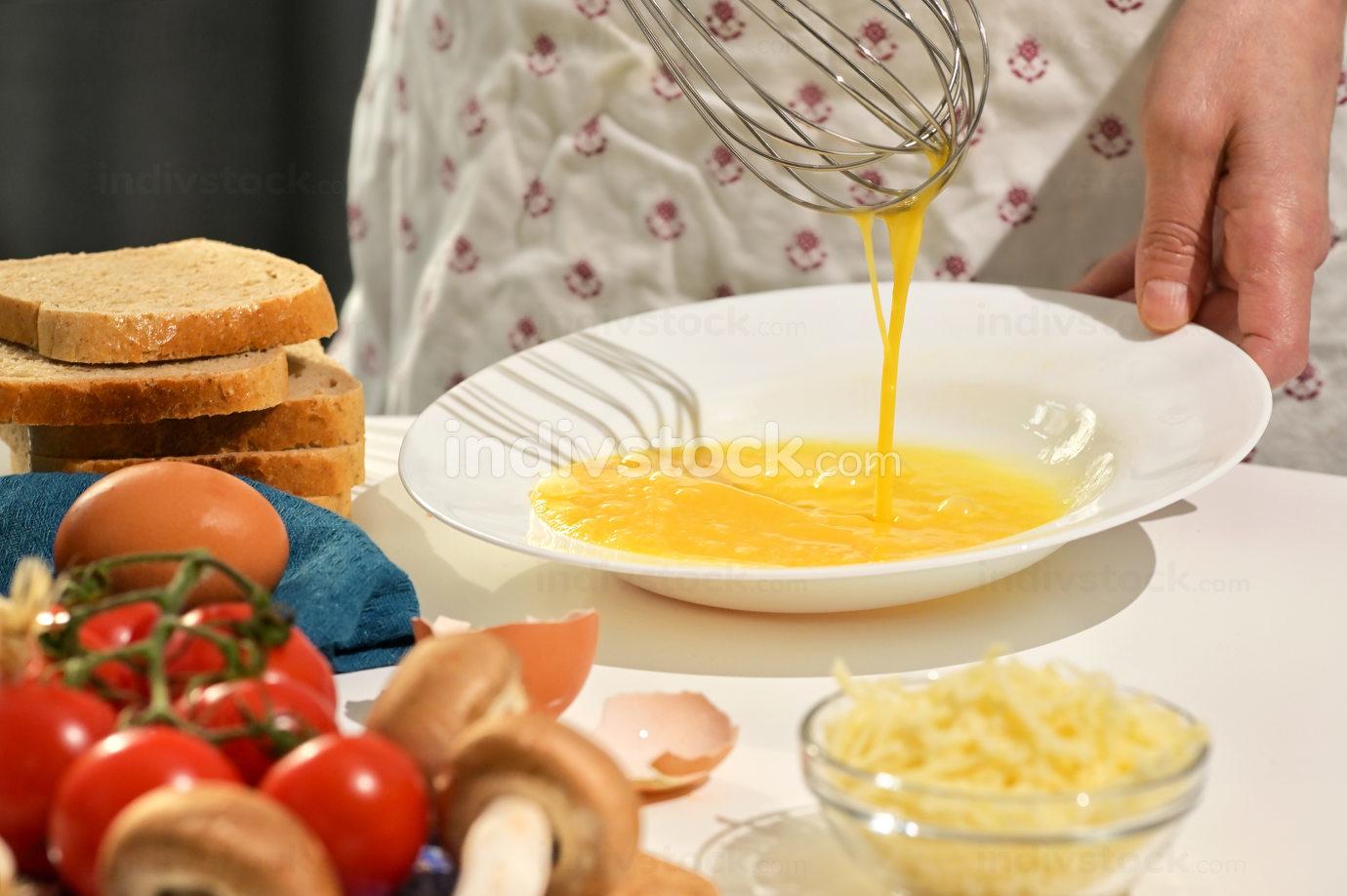 Beaten Eggs to Prepare An Omelette