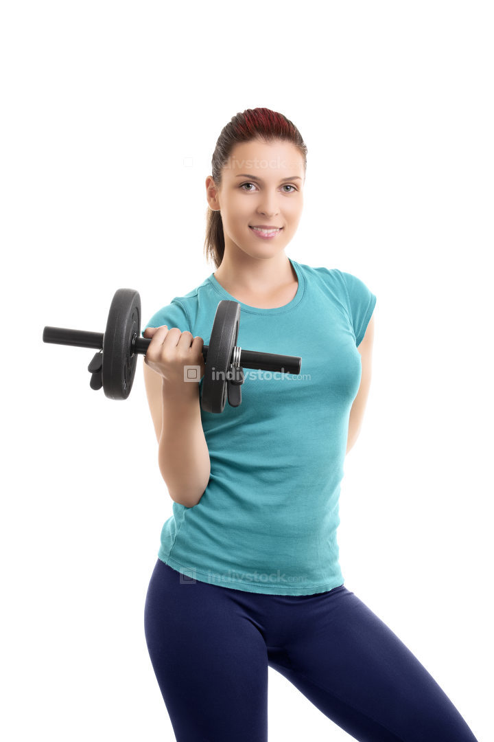Beautiful fit girl lifting a dumbbell