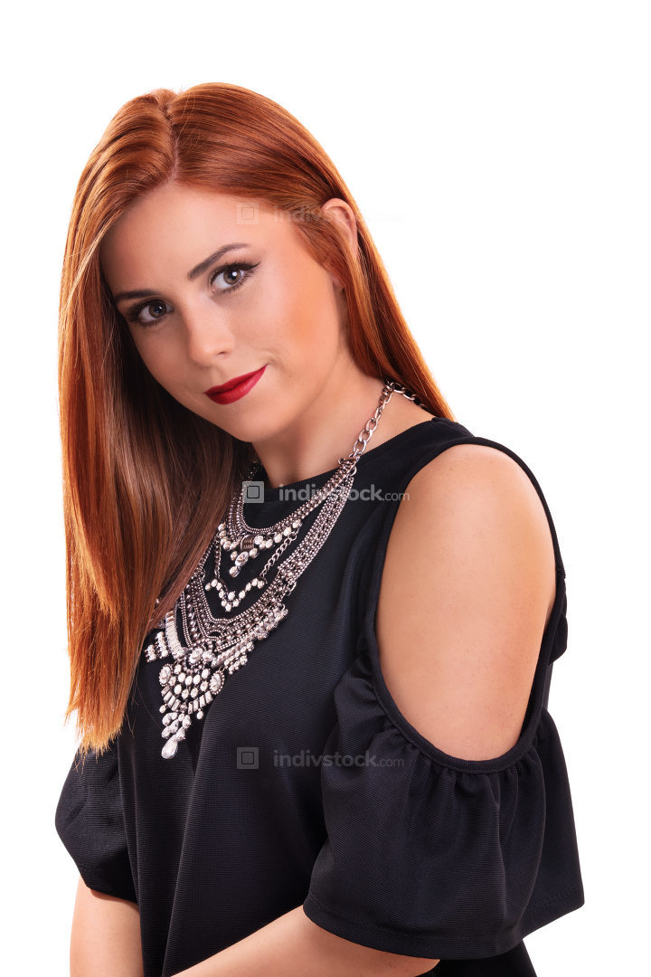 Beautiful redheaded young woman with big stylish silver necklace