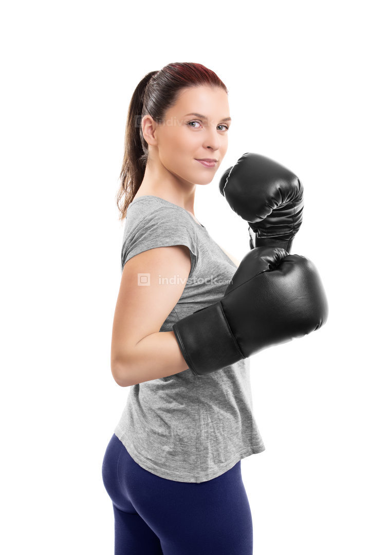 Beautiful young woman with boxing gloves