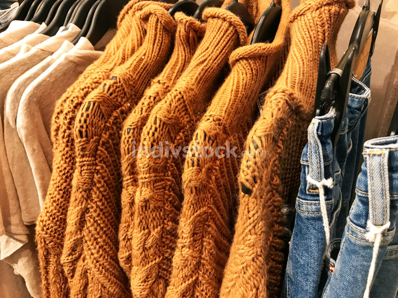 Different types of winter sweaters for sale at a nearby store