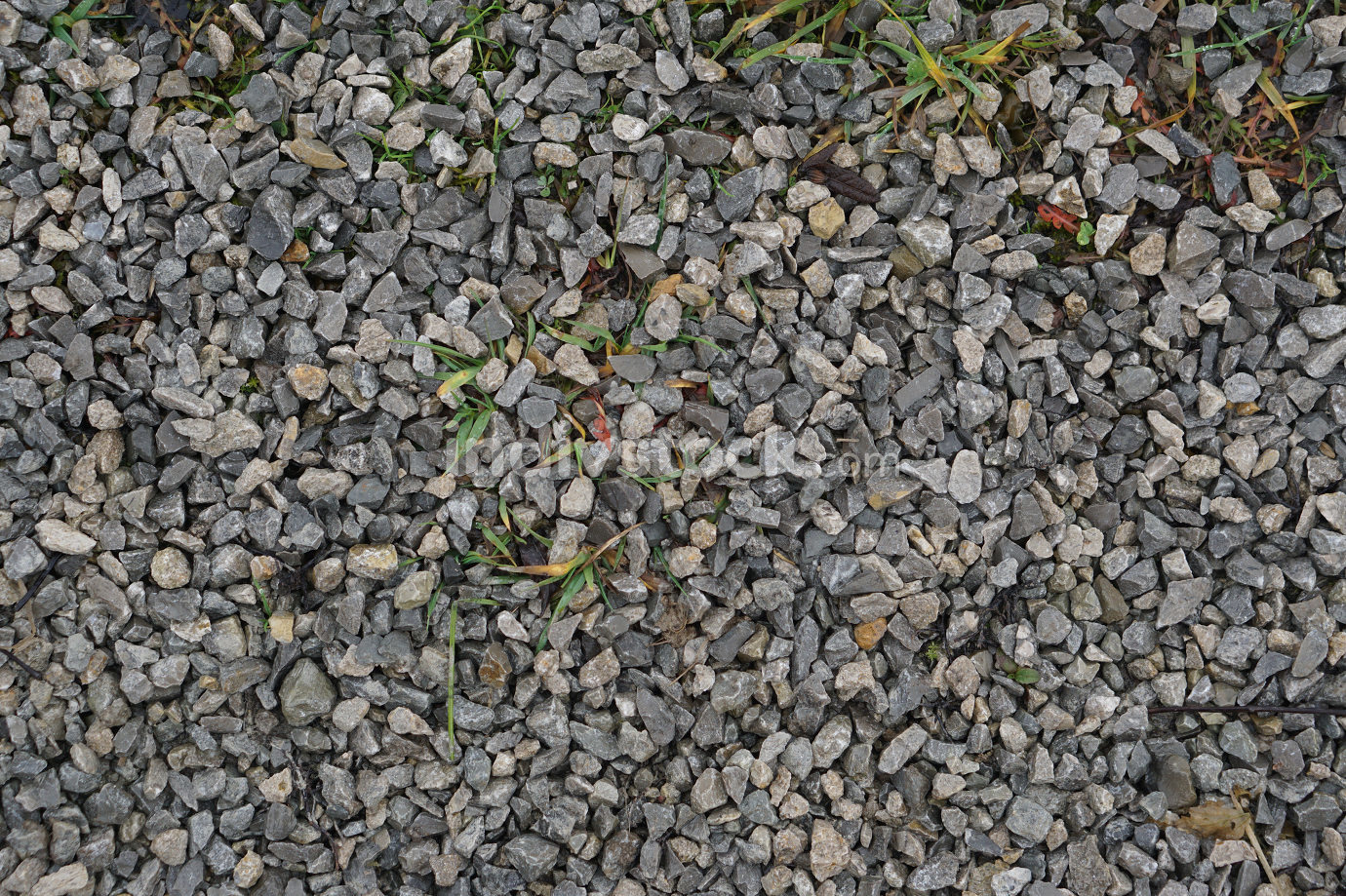 dirt road with small pebbles natural background after rain