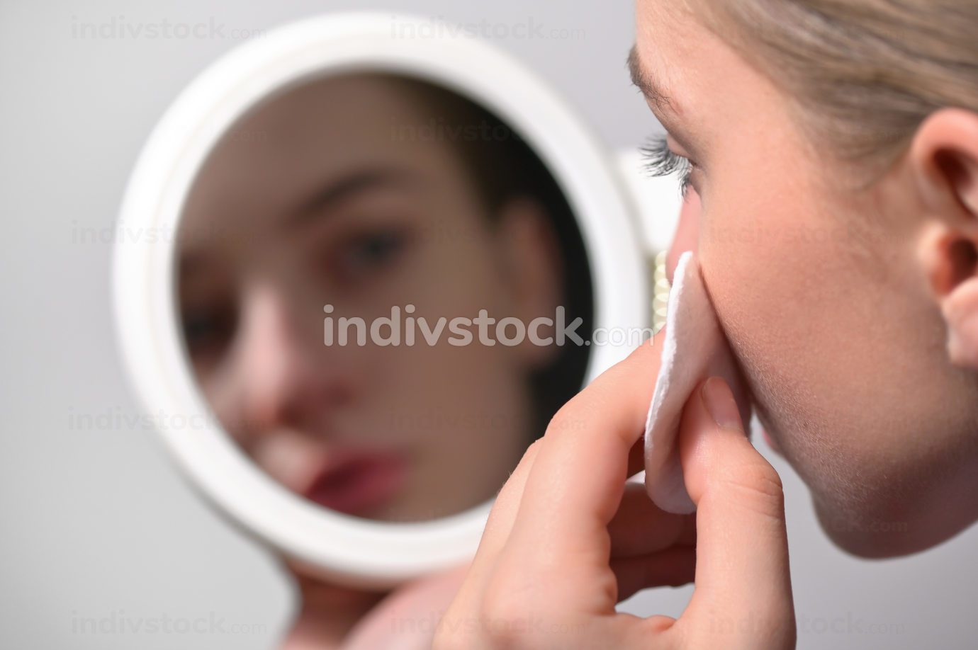Girl Wipes Her Face With A Cotton Pad