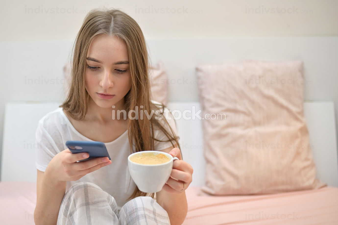 Girl With Cup Of Coffee In Bedroom
