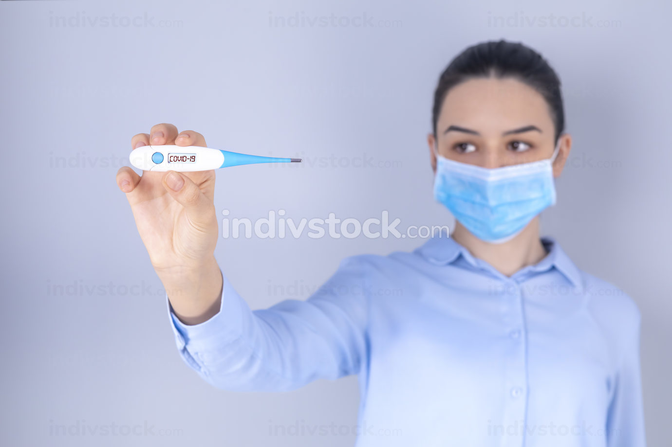 Girl with mask on face check fever