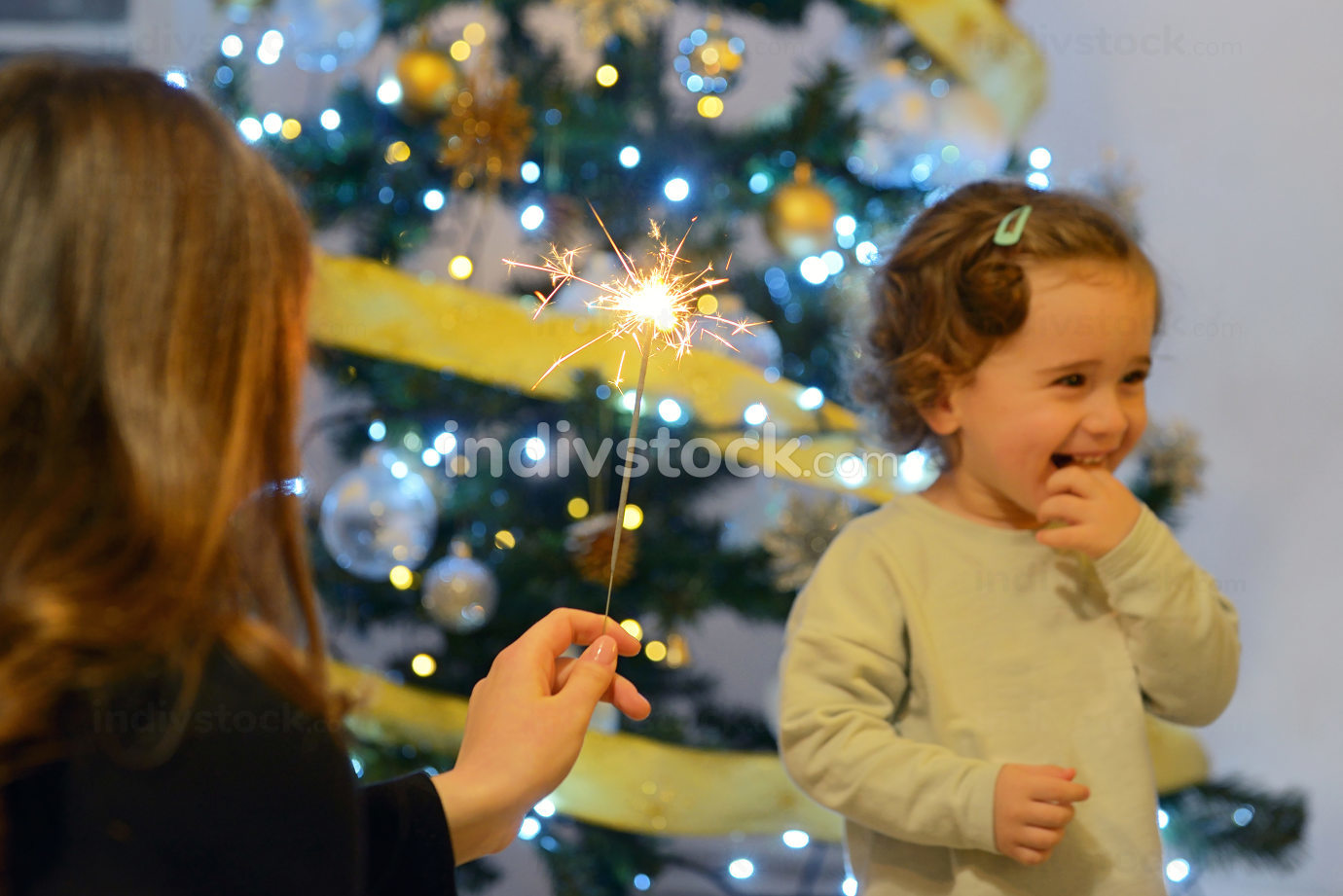 Girls looking at festive fire sparks.