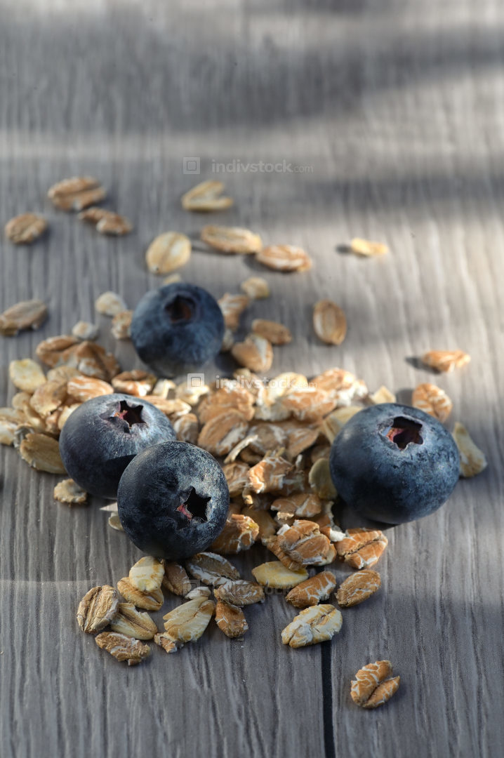 Muesli And Fresh Berries on wooden table