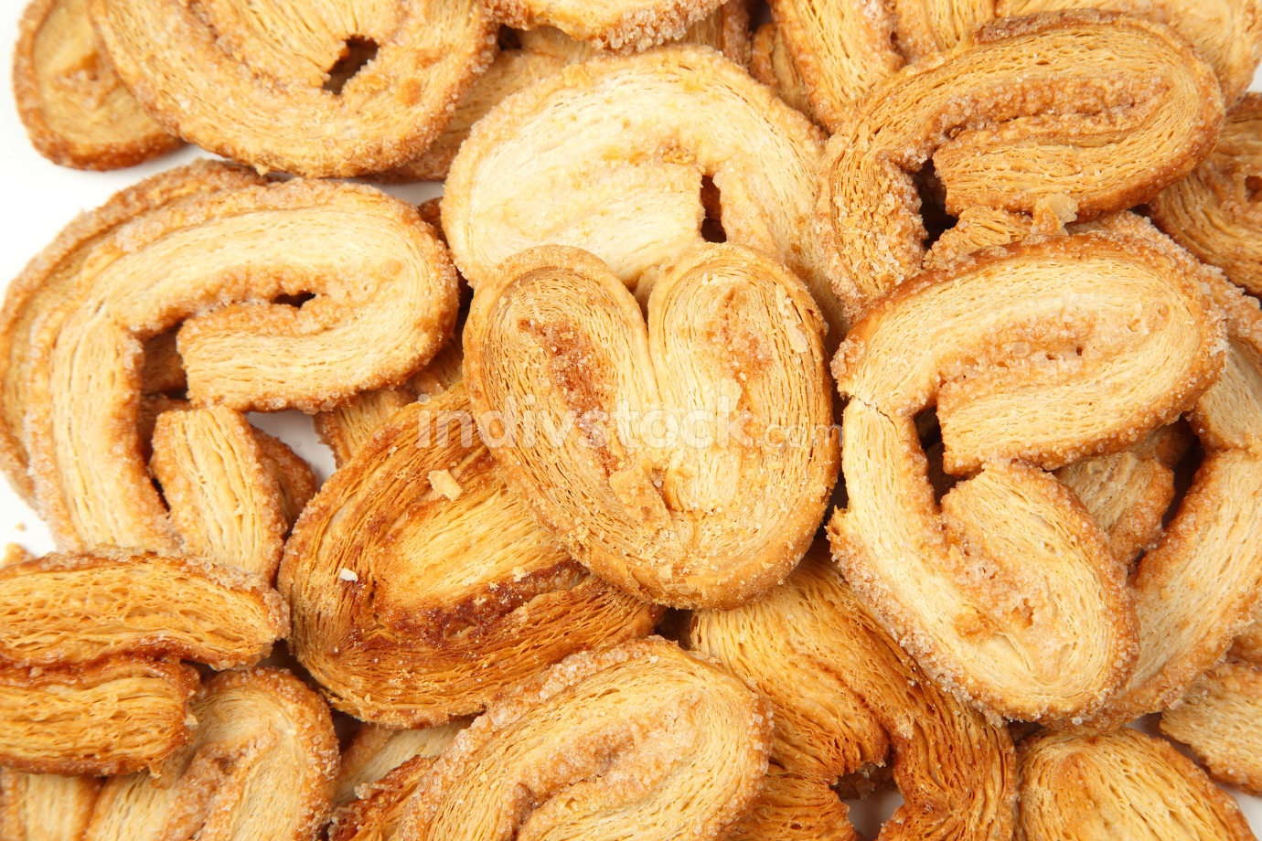 multiple layered shortbread cookies on white isolated background