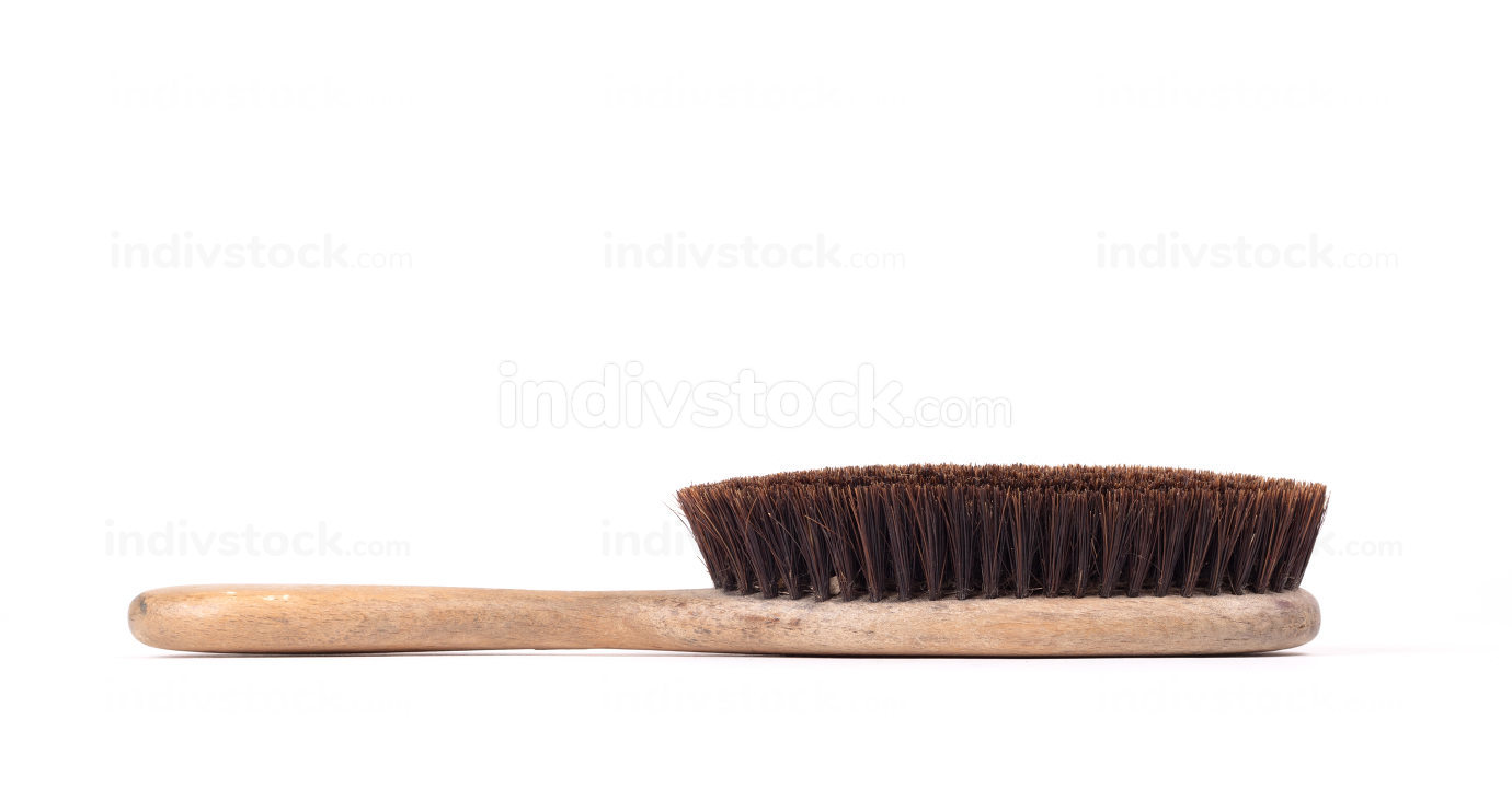 Old hair brush with some hair in it