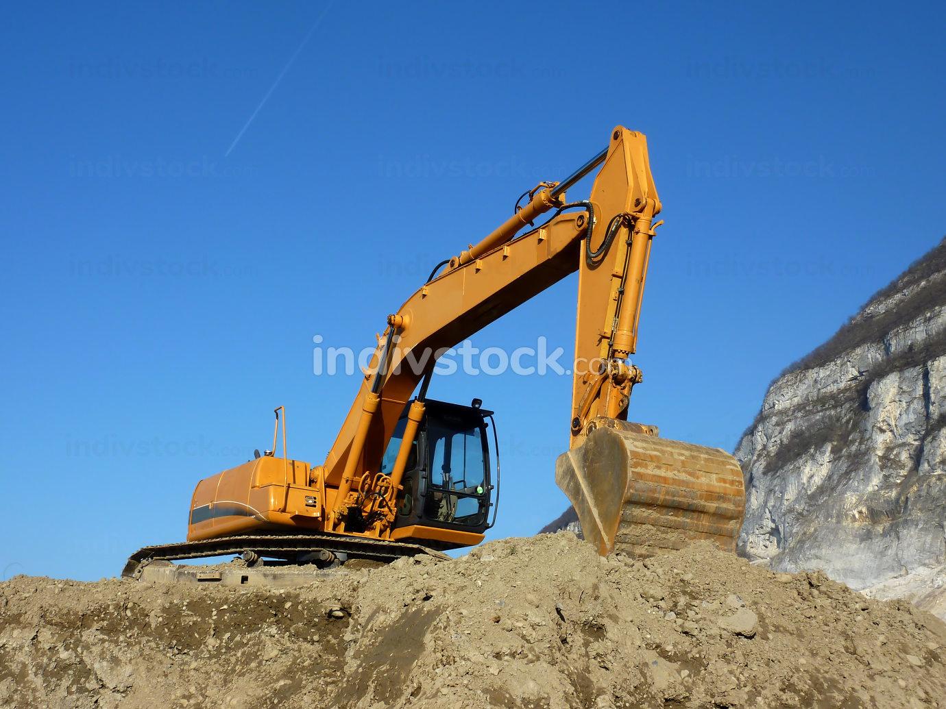 Orange mechanical digger
