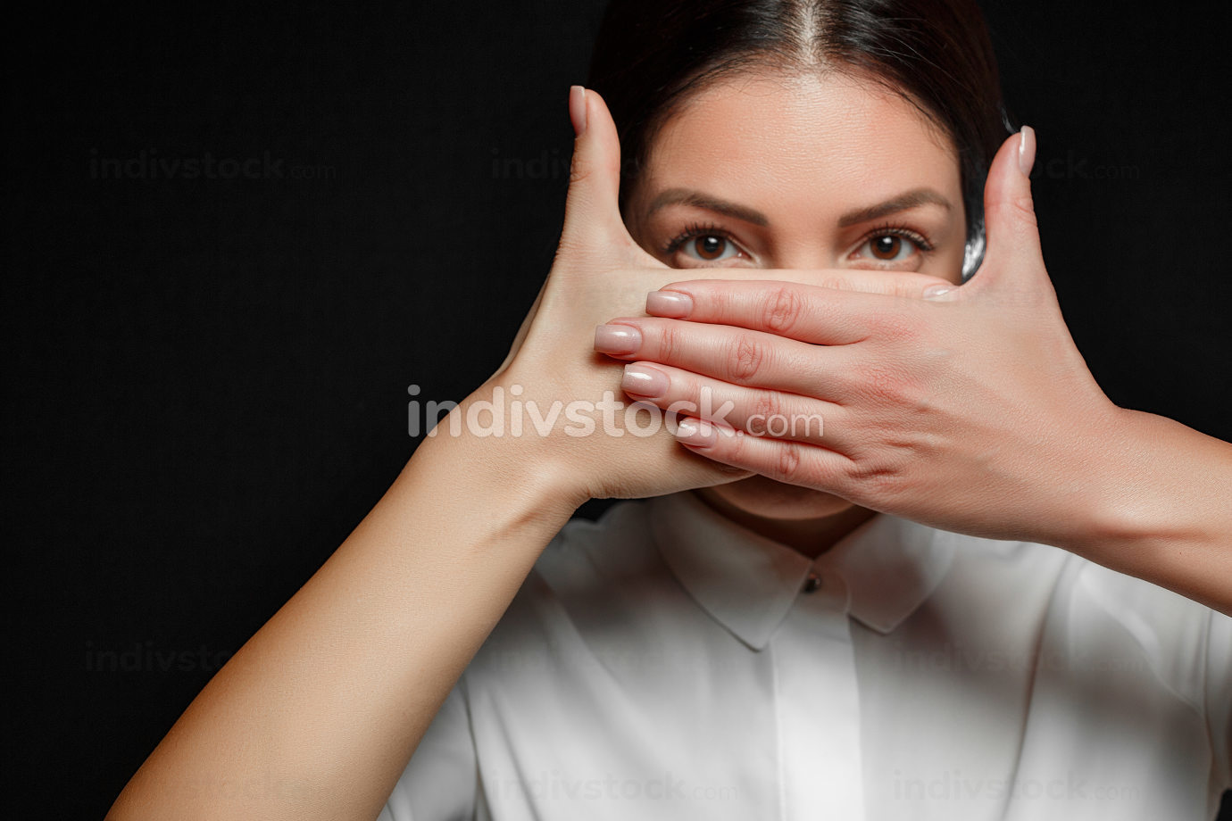 portrait of Asian brunette woman in white shirt with mouth cover