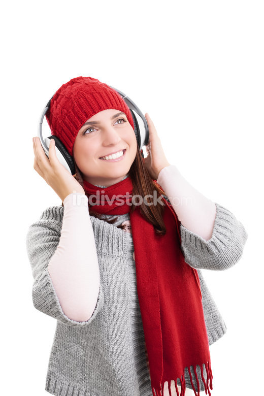 Smiling girl in winter clothes with headphones