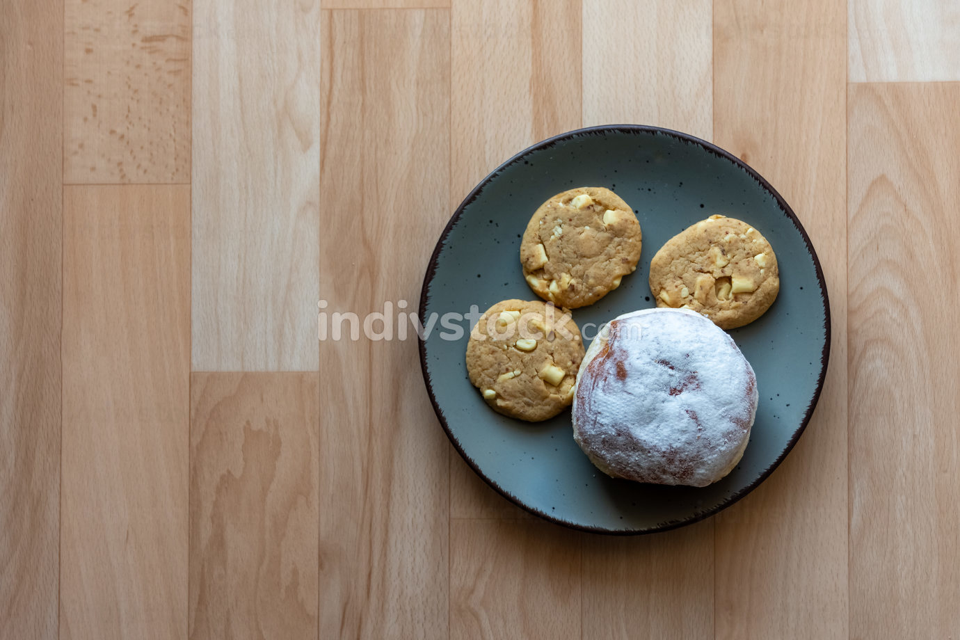 Three crunchy biscuits and bun on a plate