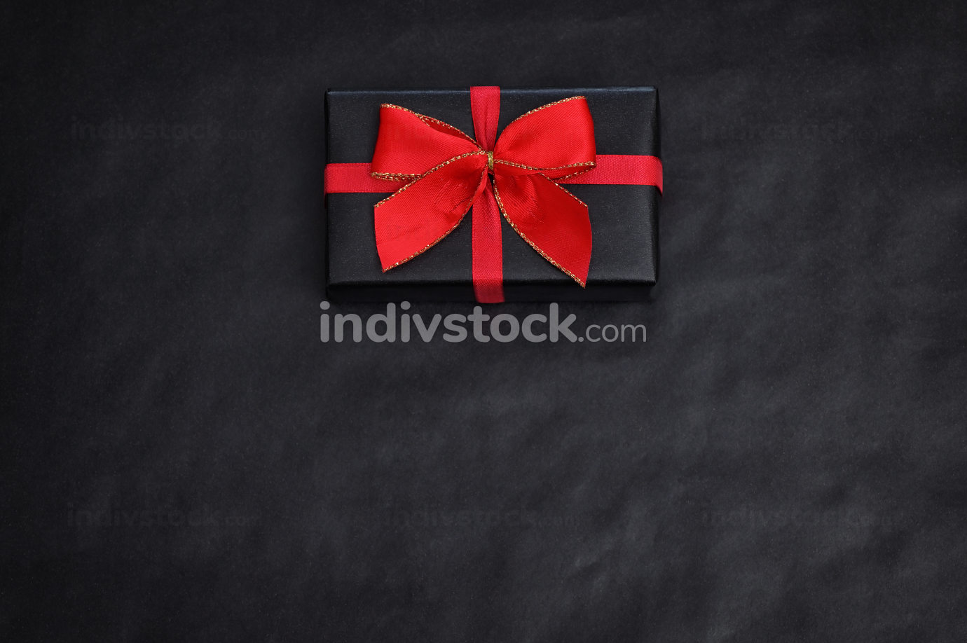 Top View Of Black Paper And A Gift