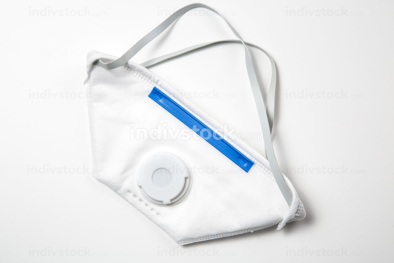 white medical protective mask against viruses and infections on a white background