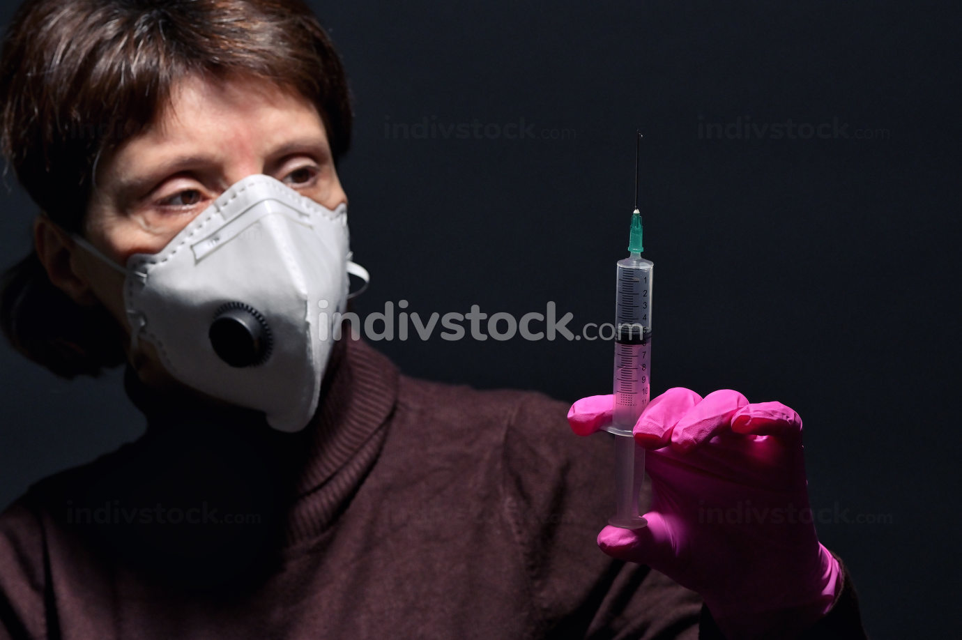 Woman Wearing Medical Protective Mask and Syringe
