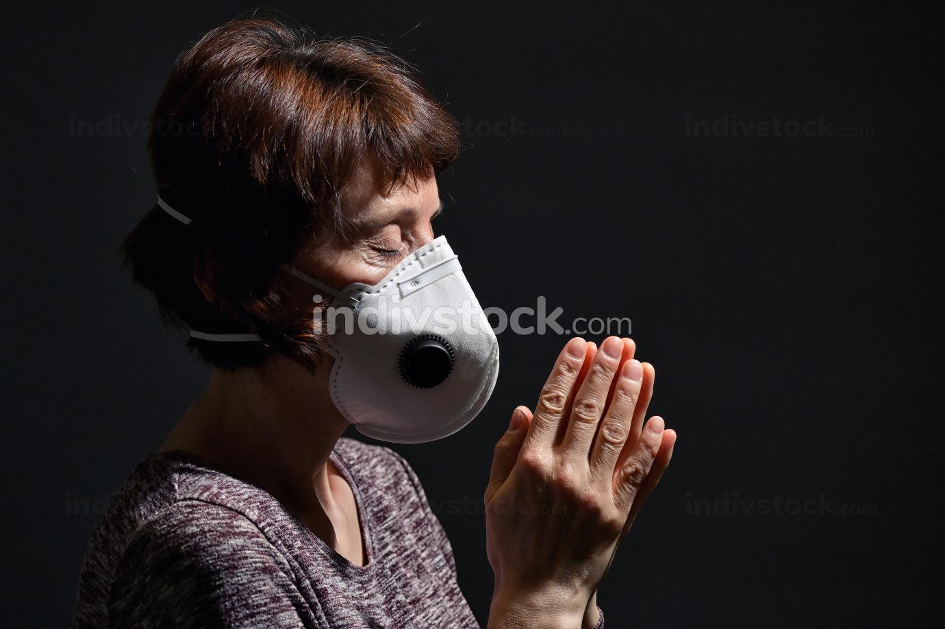 Woman Wearing Medical Protective Virus Mask and pray