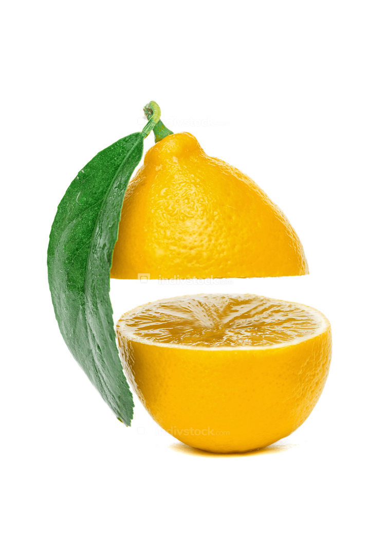 yellow lemon cut into two parts with a leaf isolated on a white