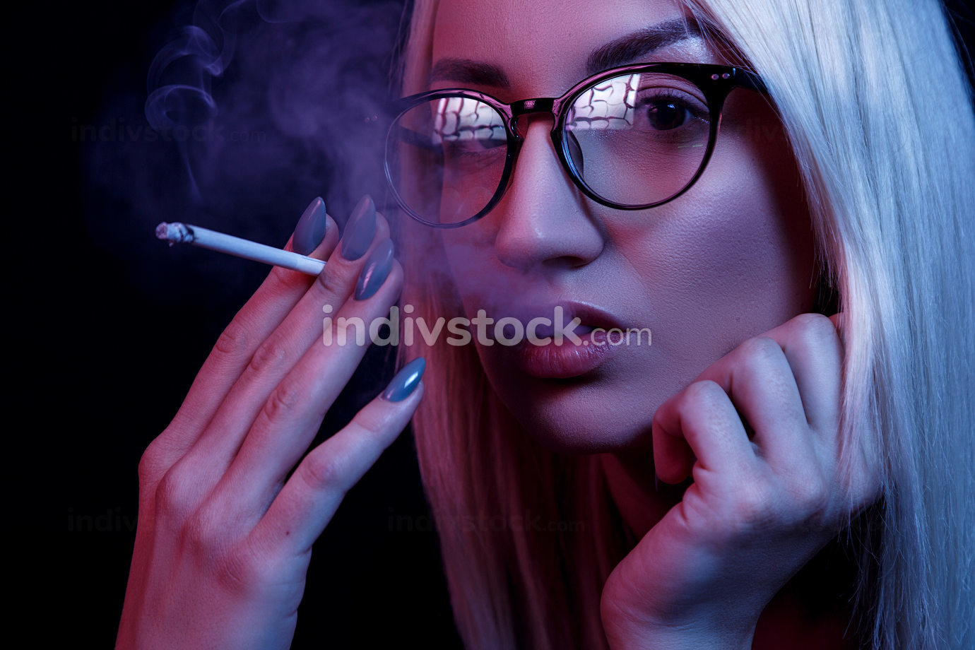 young Caucasian beautiful blonde woman with glasses Smoking. close-up portrait in neon light