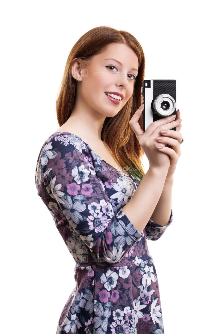Young girl holding old film camera