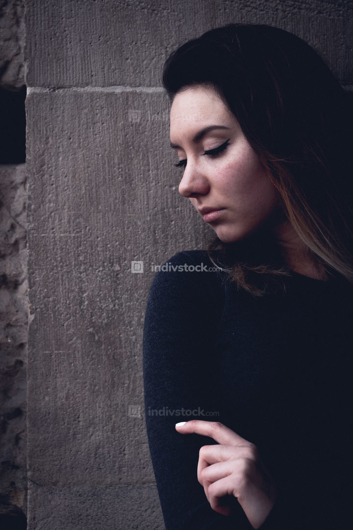 Young moody woman with downcast eyes