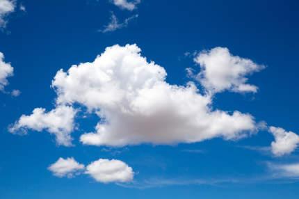 A beautiful blue sky with a big white cloud
