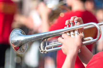 A jazz trumpeter plays of his trumpet in the brass band during a