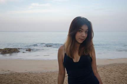 Asian woman on beach