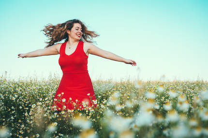 blonde woman with red dress spinning in the field