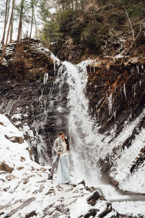 bride and groom on the mountain waterfall
