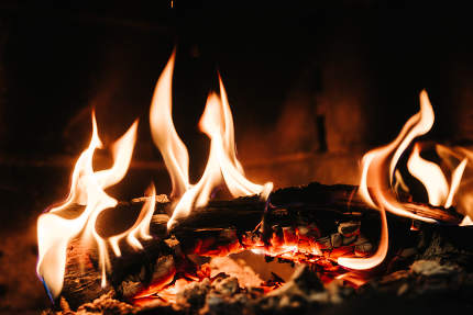 burning smoldering fire in a stone fireplace