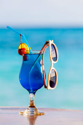 Cocktails, colorful with fruits and sunglasses on the beach