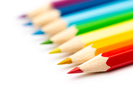 Colorful color wooden pencils on a white background