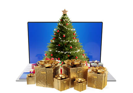 computer and christmas tree with presents. golden christmas gift